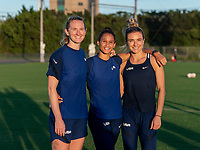 KASHIMA, JAPAN - AUGUST 4: Samantha Mewis #3, Lynn Williams #21, and Kristie Mewis #6 of the USWNT pose for a photo after a training session at the practice field on August 4, 2021 in Kashima, Japan.