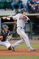 Anthony Hatch #11 of the Great Lakes Loons follows through on his swing versus the Dayton Dragons at Fifth Third Field April 22, 2009 in Dayton, Ohio. (Photo by Brian Westerholt / Four Seam Images)