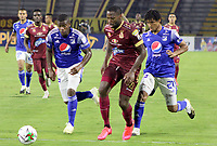 IBAGUE - COLOMBIA, 06-10-2020: Leyvin Balanta del Tolima disputa el balón con Andres Felipe Roman y Carlos Pereira de Millonarios durante partido entre Deportes Tolima y Millonarios por la fecha 12 de la Liga BetPlay DIMAYOR 2020 jugado en el estadio Manuel Murillo Toro de la ciudad de Ibagué. / Leyvin Balanta of Tolima vies for the ball with Andres Felipe Roman and Carlos Pereira of Millonarios during match between Deportes Tolima and Millonarios for the date 12 as part BetPlay DIMAYOR League 2020 played at Manuel Murillo Toro stadium in Ibague city.  Photo: VizzorImage / Juan Torres / Cont