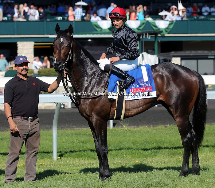April 19, 2014 Mr Speaker and jockey Jose Lezcano in the winner's circle after winning the Coolmore Lexington Stakes
