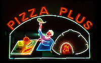 . Pizza Plus Illuminated Restaurant Sign in Limassol, Cyprus.. europe, mediterranean, Cyprus, island, limassol , centre, south, coast, urban, lifestyle, modern, fast, food, advertising, electricity,sign,night,lit,up, neon, lights, cooking, eating, vacation, foreign, abroad, world, travel, destinations.