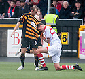"Alloa""s Greig Spence looks bemused as Stirling's Lewis Coult takes a liking to his football top."