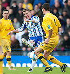 GLASGOW, SCOTLAND - JANUARY 28:  Dean Shiels of Kilmarnock and Ayr's John Robertson during the Scottish Communities Cup Semi Final match between Ayr United and Kilmarnock at Hampden Park on January 28, 2012 in Glasgow, United Kingdom. (Photo by Rob Casey/Getty Images).