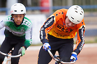 13 SEP 2014 - IPSWICH, GBR - Ricki Johnson (right) from Wednesfield Aces tries to get away from Robert Croal from Exeter Aces during a first semi final heat of the 2014 British Open Club Cycle Speedway Championships at Whitton Sports & Community Centre in Ipswich, Great Britain (PHOTO COPYRIGHT © 2014 NIGEL FARROW, ALL RIGHTS RESERVED)