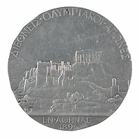 BNPS.co.uk (01202) 558833.<br /> Pic: RR Auction/BNPS<br /> <br /> Pictured: The winners medal was silver and not gold<br /> <br /> An extremely rare winner's medal from the first ever Olympics has sold for £131,000 following a bidding war. ($180,000)<br /> <br /> The unknown champion received a silver medal for coming first at the 1896 games in Athens, Greece.<br /> <br /> The runner-up got a bronze medal and there was no reward for finishing third.