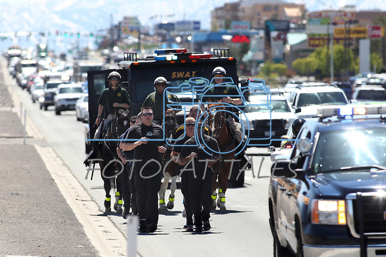 Members of the Carson City Sheriff's Office participate in the 12th Annual Law Enforcement Memorial Relay Run into South Carson City, Nev., on Wednesday, May 4, 2011. Law enforcement representatives from throughout Nevada relay a baton containing the names of the 117 officers killed in the history of the state. .Photo by Cathleen Allison