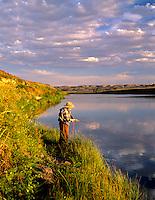 Fly fisherman on banks of Owyhee River. Near Rome, Oregon.
