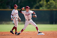 Saint Joseph's Hawks shortstop Matt Cuppari (23) throws to first base as second baseman Chris Skermo (9) looks on during a game against the Ball State Cardinals on March 9, 2019 at North Charlotte Regional Park in Port Charlotte, Florida.  Ball State defeated Saint Joseph's 7-5.  (Mike Janes/Four Seam Images)