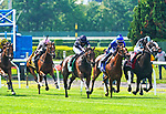 Santa Barbara (IRE) #5, ridden by jockey Ryan Moore wins the Belmont Oaks Invitational (Grade 1) at Belmont Park in Elmont, New York on July 10, 2021. Dan Heary/Eclipse Sportswire/CSM