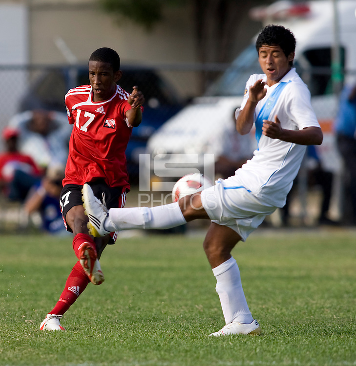 Luis Perez (11) of Guatemalablocks the pass of Kiel Pierre (17) of Trinidad & Tobago  during the group stage of the CONCACAF Men's Under 17 Championship at Jarrett Park in Montego Bay, Jamaica. Trinidad & Tobago defeated Guatemala, 1-0.