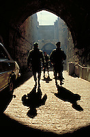 TITLE - DISTANT RELATIONS, ISRAELI ARMY PATROLS THE STREETS OF JERUSALEM,. JERUSALEM ISRAEL.