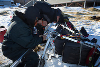 David Walker and Bernard Edwards help repair Jodi Bailey's sled at the Shageluk checkpoint on Saturday March 9, 2013...Iditarod Sled Dog Race 2013..Photo by Jeff Schultz copyright 2013 DO NOT REPRODUCE WITHOUT PERMISSION
