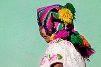 A Maya woman wearing a colorful hand woven headscarf stands in the market of San Francisco El Alto, Guatemala, 3 December 2004.