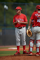 GCL Phillies East coach Roly de Armas (8) makes a pitching change during a Gulf Coast League game against the GCL Yankees East on July 31, 2019 at Yankees Minor League Complex in Tampa, Florida.  GCL Yankees East defeated the GCL Phillies East 11-0 in the first game of a doubleheader.  (Mike Janes/Four Seam Images)