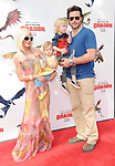 Tori Spelling McDermott,Stella Doreen McDermott,Liam Aaron McDermott & Dean McDermott at the Dreamwork Pictures' Premiere How to Train Your Dragon held at Gibson Universal in Universal City, California on March 21,2010                                                                   Copyright 2010  DVS / RockinExposures