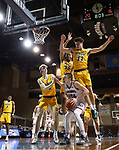 SIOUX FALLS, SD - MARCH 8: Tasos Kamateros #34 of the South Dakota Coyotes gets surrounded by South Dakota Coyotes defenders during the Summit League Basketball Tournament at the Sanford Pentagon in Sioux Falls, SD. (Photo by Richard Carlson/Inertia)