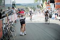 race winner Pauline Ferrand Prevot (FRA/Rabobank-Liv) hugging teammate/world champion/legend Marianne Vos (NLD/Rabobank-Liv) just accross the finish line<br /> <br /> La Flèche Wallonne 2014