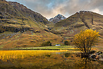 Glencoe, Scotland: Solitary house in the Scotish Highlands along the river Coe in evening light