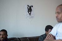 On the right: Temsgen, refugee from Eritrea.<br /> On the wall a poster of Khaled. He was murdered under unkown circumstances. The police arrested a refugee from Eritrea, but the refugees do not believe that he is the murder.<br /> 13.2.2015, Dresden<br /> Copyright: Christian-Ditsch.de<br /> [Inhaltsveraendernde Manipulation des Fotos nur nach ausdruecklicher Genehmigung des Fotografen. Vereinbarungen ueber Abtretung von Persoenlichkeitsrechten/Model Release der abgebildeten Person/Personen liegen nicht vor. NO MODEL RELEASE! Nur fuer Redaktionelle Zwecke. Don't publish without copyright Christian-Ditsch.de, Veroeffentlichung nur mit Fotografennennung, sowie gegen Honorar, MwSt. und Beleg. Konto: I N G - D i B a, IBAN DE58500105175400192269, BIC INGDDEFFXXX, Kontakt: post@christian-ditsch.de<br /> Bei der Bearbeitung der Dateiinformationen darf die Urheberkennzeichnung in den EXIF- und  IPTC-Daten nicht entfernt werden, diese sind in digitalen Medien nach §95c UrhG rechtlich geschuetzt. Der Urhebervermerk wird gemaess §13 UrhG verlangt.]