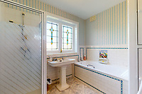BNPS.co.uk (01202 558833)<br /> Pic: Savills/BNPS<br /> <br /> Pictured: A bathroom.<br /> <br /> A clifftop home with breathtaking panoramic sea views is on the market for £3.25m.<br /> <br /> Sandpierre also has a private swimming pool and a viewing platform overlooking the beach with 180-degree views of the water. <br /> <br /> The six-bedroom family home is on the Bournemouth/Poole coastline in Dorset and is being sold for the first time in 25 years.<br /> <br /> The house was built in the 1930s and is in a quiet cul-de-sac in Branksome Dene Chine - midway between the town centres of Bournemouth and Poole.