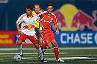 New York Red Bulls forward Juan Pablo Angel (9) is marked by Toronto FC midfielder Kevin Harmse (5). The New York Red Bulls defeated Toronto FC 2-0 during a Major League Soccer match at Giants Stadium in East Rutherford, NJ, on August 17, 2008.