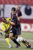 The MetroStars' Kenny Arena pushes the Crew's Jeff Cunningham off the ball. The Columbus Crew and the MetroStars played to a 1-1 tie in regular season MLS action on Saturday October 9, 2004 at Giant's Stadium, East Rutherford, NJ..