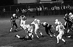 """Bethel Park PA:  Offensive play with Mike Stewart 11 trying to complete a pass to Bruce Evanovich 80.  Mike didn't get much help with the three """"look out"""" blocks from Clark Miller 30, Joe Barrett 75, and Dennis Franks 66. Others in the photo; Jim Dingeldine 73.  The Bethel Park defense played very well in the 13-6 win at Chartiers Valley Stadium. The game went down to the last play of the game when Mike Stewart threw a 65 TD pass to Gary Biro 81.  The defensive unit was one of the best in Bethel Park history only allowing a little over 7 points a game."""