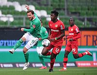 18th May 2020, WESERSTADION, Bremen, Germany; Bundesliga football, Werder Bremen versus Bayer Leverkusen;  Philipp Bargfrede (Bremen) clears the ball away from Edmond Tapsoba (Leverkusen).