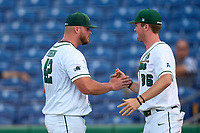 Tulane Green Wave pitcher Trent Johnson (42) shakes hands with Robert Price (36) after being pulled from a game against the Houston Cougars on May 25, 2021 at BayCare Ballpark in Clearwater, Florida.  Tulane defeated Houston 4-1 in the opening game of the American Athletic Conference Tournament.  (Mike Janes/Four Seam Images)