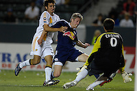 New York Red Bulls John Wolyniec shoots as  Los Angeles Galaxy's Ty Harden plays defense during the first half of US Open Cup qualifying at the Home Depot Center in Carson, CA on Tuesday, May 8, 2007.