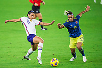 ORLANDO, FL - JANUARY 18: Lynn Williams #6 of the USWNT, Jessica Caro #8 of Colombia battle for the ball during a game between Colombia and USWNT at Exploria Stadium on January 18, 2021 in Orlando, Florida.