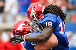 Southern Methodist Mustangs wide receiver Darius Joseph (18) and Southern Methodist Mustangs offensive linesman Taylor Lasecki (52) in action during the game between the TCU Horned Frogs and the SMU Mustangs at the Gerald J. Ford Stadium in Fort Worth, Texas.  TCU leads SMU 28 to 0 at half.