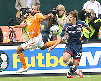 Dwayne DeRosario #14 of Houston and Wells Thompson #27 of the Revolution battle over a loose ball. The Houston Dynamo defeated the New England Revolution 2-1 in the finals of the MLS Cup at RFK Memorial Stadium in Washington, D. C., on November 18, 2007.