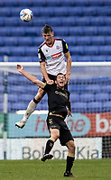 Bolton Wanderers' Ryan Delaney competing with Oldham Athletic's Ben Garrity (right) <br /> <br /> Photographer Andrew Kearns/CameraSport<br /> <br /> The EFL Sky Bet League Two - Bolton Wanderers v Oldham Athletic - Saturday 17th October 2020 - University of Bolton Stadium - Bolton<br /> <br /> World Copyright © 2020 CameraSport. All rights reserved. 43 Linden Ave. Countesthorpe. Leicester. England. LE8 5PG - Tel: +44 (0) 116 277 4147 - admin@camerasport.com - www.camerasport.com