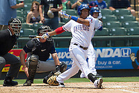 Round Rock Express second baseman Yangervis Solarte (26) follows through on his swing against the Colorado Springs Sky Sox in the Pacific Coast League baseball game on May 19, 2013 at the Dell Diamond in Round Rock, Texas. Colorado Springs defeated Round Rock 3-1 in 10 innings. (Andrew Woolley/Four Seam Images).