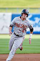 Andrew Susac (5) of the Fresno Grizzlies rounds the bases  against the Salt Lake Bees at Smith's Ballpark on April 9, 2014 in Salt Lake City, Utah.  (Stephen Smith/Four Seam Images)