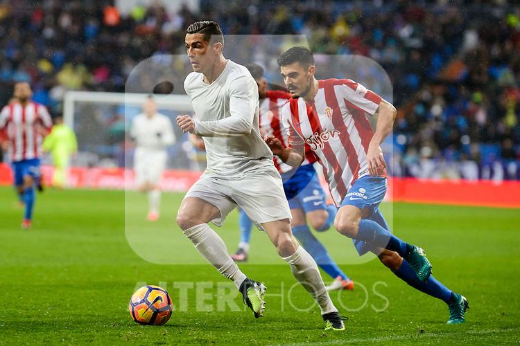 Real Madrid's player Cristiano Ronaldo and Sporting de Gijon's player Meré during match of La Liga between Real Madrid and Sporting de Gijon at Santiago Bernabeu Stadium in Madrid, Spain. November 26, 2016. (ALTERPHOTOS/BorjaB.Hojas)