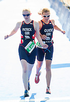 31 MAY 2014 - LONDON, GBR - PT5 category competitor Alison Patrick (GBR) left) of Great Britain is guided to the finish of the 2014 ITU World Triathlon Series PT5 Paratriathlon in Hyde Park, London, Great Britain by Jenny Manners (right) (PHOTO COPYRIGHT © 2014 NIGEL FARROW, ALL RIGHTS RESERVED)