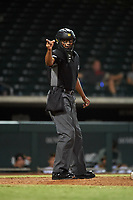 Home plate umpire Jose Navas calls a strike on a batter during an Arizona Fall League game between the Peoria Javelinas and Mesa Solar Sox on September 21, 2019 at Sloan Park in Mesa, Arizona. Mesa defeated Peoria 4-1. (Zachary Lucy/Four Seam Images)