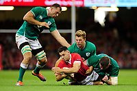 Tomos Williams of Wales is tackled by Tadhg Furlong of Ireland during the under armour summer series 2019 match between Wales and Ireland at the Principality Stadium, Cardiff, Wales, UK. Saturday 31st August 2019