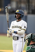 Michigan Wolverines outfielder Christian Bullock (5) at the plate against the Michigan State Spartans on March 22, 2021 in NCAA baseball action at Ray Fisher Stadium in Ann Arbor, Michigan. Michigan State beat the Wolverines 3-0. (Andrew Woolley/Four Seam Images)