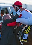 March 29, 2014: Rosie Napravnik, rider of Vicar's In Trouble, gets a hug from owner Ken Ramsey, after leading the way in a wire-to-wire win in the Louisiana Derby on Louisiana Derby Day at the Fairgrounds Race Course in New Orleans, LA. Scott Serio/ESW/CSM