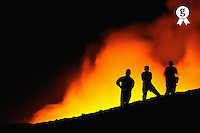 People watching lava flowing to the sea (Licence this image exclusively with Getty: http://www.gettyimages.com/detail/83749916 )