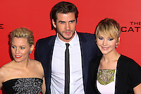 """NEW YORK, NY - NOVEMBER 20: Elizabeth Banks, Liam Hemsworth, Jennifer Lawrence at the New York Premiere Of Lionsgate's """"The Hunger Games: Catching Fire"""" held at AMC Lincoln Square Theater on November 20, 2013 in New York City. (Photo by Jeffery Duran/Celebrity Monitor)"""