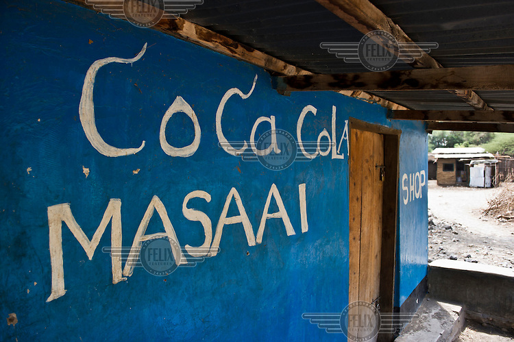 A local shop advertises Coca Cola on the road between Arusha and Loliondo. The government of Tanzania is planning to turn this dirt track into a highway that will connect isolated communities and bring much needed development to the marginalised Masaai. However, the highway will cut straight through the Serengeti National Park, a World Heritage Site, disrupting animal migration, which would have disastrous consequences for the entire park ecosystem.