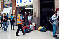 British Transport police officer walking over to talk to a down and out that has fallen over from excess alcohol on the concourse of a British Rail mainline station. This image may only be used to portray the subject in a positive manner..©shoutpictures.com..john@shoutpictures.com