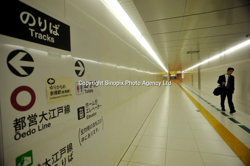 A businessman in an underground tunnel in the Shinbashi district of downtown Tokyo, Japan. .11 Jun 2009