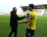 Jake Wright of Oxford United shakes hands with Michael Appleton manager of Oxford United   during the Emirates FA Cup 3rd Round between Oxford United v Swansea     played at Kassam Stadium  on 10th January 2016 in Oxford