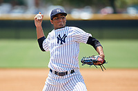 GCL Yankees East relief pitcher Jairo Garcia (32) warms up on a side field during a game against the GCL Blue Jays on August 2, 2018 at Yankee Complex in Tampa, Florida.  GCL Yankees East defeated GCL Blue Jays 5-4.  (Mike Janes/Four Seam Images)