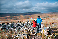 "Pictured: Dr Peter Pare (R) with his wife by the wreckage of the Wellington Bomber MF509 in the Brecon Beacons, Wales, UK. <br /> Re: The nephew of a World War II airman whose plane crashed into a Welsh mountain has climbed the peak to pay tribute to the uncle he never met.<br /> Dr Peter Paré, 74, travelled from his home in Vancouver, Canada, to read a poem at the desolate spot where his uncle Bill Allison was killed.<br /> Flying officer Allison, 28, was one of the six crew of a Wellington Bomber that crashed on a training flight in November 1944.<br /> The plane wreckage is still scattered over Carreg Goch in the Brecon Beacons where hundreds of young airmen learned to prepare for bombing missions.<br /> Dr Paré said: ""I wanted to make this pilgrimage even though I was a baby when he died and never met Bill Allison.<br /> ""We only found out about the crash site recently and it is remarkable that so much of the plane is still here.""<br /> Flying officer Allison was the oldest on board when the plane's starboard engine developed a fault during a low-flying exercise.<br /> For years local people have honoured the brave airmen by flying a Canadian flag at the scene - replacing it every time it gets ripped by strong winds.<br /> Dr Paré, retired Professor of Medicine at the University of British Columbia, said: ""It was very moving to see the Maple Leaf flying where my uncle died all those years ago.<br /> ""It brought a tear to my eye as I read the poem I wrote in his honour."""